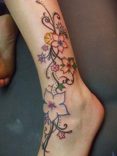 flower-tattoo-designs-on-leg-for-women