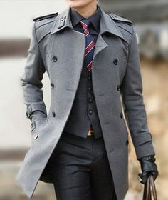 Nail that dapper look with a grey overcoat and charcoal plaid dress pants. Black Dress Shirt — Red and Navy Vertical Striped Tie — Charcoal Plaid Waistcoat — Grey Overcoat — Charcoal Plaid Dress Pants — Black Leather Gloves Dress Shirt And Tie, Suit And Tie, Man In Suit, Sharp Dressed Man, Well Dressed Men, Grey Overcoat, Mens Overcoat, Gray Coat, Look Fashion