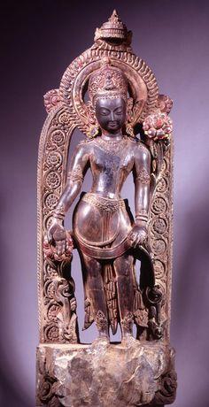 POLISHED STONE FIGURE OF PADMAPANI NEPAL, KATHMANDU VALLEY CIRCA 16TH CENTURY