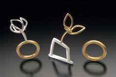 "Sarah Hood, Three Rings   from Structural Series #2: Deconstruction  1999  18k gold, sterling silver  each approx. 1"" x 2"" x .5""  one-of-a-kind  $3980 (set of three)"