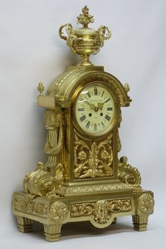 19th century French ormolu bracket clock, case cast with scrolls acanthus and masks with urn cresting and pineapple finials, cream Roman dial signed 'H Haudebine et Fils Paris', twin train Japy Freres movement striking on bell, H63cm - Fine Furniture, Clocks & Rugs 10/12/16