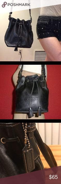 """RARE vintage COACH bucket bag! GENUINE COACH SMALL Black LEATHER DRAWSTRING BUCKET BAG. SHOULDER STRAP HAS BUCKLE ADJUSTMENT EACH SIDE TO MAX 15"""" DROP. INTERIOR IS LINED WITH BEIGE GROSGRAIN AND HAS ZIP POCKET. SILVER-TONE HARDWARE, TASSELED LEATHER DRAWSTRING. Price firm unless bundled. 30% discount! Ask any questions you may have ! Coach Bags Shoulder Bags"""