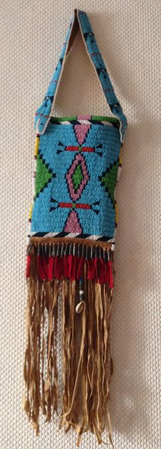 CHEYENNE STYLE BEADED BAG WITH WOODEN MIRROR. BUCKSKIN. FRENCH BEADS.