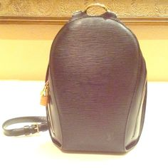 Louis Vuitton Black Epi Leather backpack Gorgeous 100% Authentic Black Epi Leather Backpack. Excellent condition inside and out! Lock but no key.  Serial No. VI0071.  Measures roughly 9x10. Small zippered pocket with LV zip on the back. Gray interior.  Excellent for that hands free day! Jeans or dress, this bag brings luxury to any outfit! No dust bag. Louis Vuitton Bags Backpacks