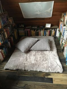 Used wooden crates for the book shelves and made an ultra soft rug from memory foam and a faux fur throw rug Faux Fur Throw, Book Shelves, Wooden Crates, Reading Nook, Throw Rugs, Memory Foam, Interiors, Bed, Furniture