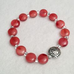 Ladies red and silver stretch beadwork bracelet, $12.5