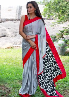 Silver semi crepe with printed crepe pallu with pink cotton silk border.