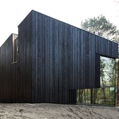 The blackened-timber facades of this house in a coastal nature reserve near The Hague are interrupted by carefully positioned openings that frame views of the surrounding forest. Modern Scandinavian Interior, Scandinavian Architecture, Timber Architecture, Architecture Design, Architecture Portfolio, Wood Facade, Timber Cladding, Black Cladding, Villa