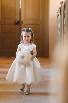 Flower girl with winter muff instead of flower basket