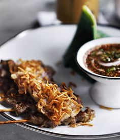 Thai sticky rice with pork satay and grilled, crispy pork belly, served with a chilli dip