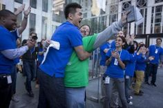 The first customer to leave the Fifth Avenue New York City store with the new Apple iPhone 5 is embraced by an Apple employee this morning. Photo by Scott Eells/Bloomberg . Click through for more from The Linkdown for Friday, Sept. 21.