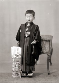 https://flic.kr/p/qsZhRd | Young Boy in Kimono, Vintage Japan | A young Japanese boy in kimono holding traditional Shichi-Go-San candy (called Chitose Ame). This photo is from a found wooden box of vintage Japanese portraits that appear to have been taken by a portrait photographer, possibly between the 1930s to 1950s in Japan.