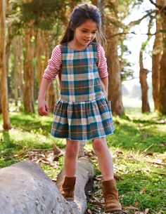 """Cosy brushed cotton with our timelessly stylish, and practical check. Dressed up or down, this is a comfortable and nostalgic dress which we think girls will want to wear and wear this season."" #MiniBoden #BackToSchool"