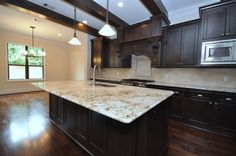 This Is The Perfect Kitchen. Granite Countertops, Stainless Steel Appliances, Dark Cabinets And Wood Floors.