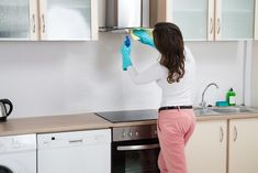 Stock Photo - Woman Cleaning Cooker Hood With Rag In Kitchen At Home Cooker Hood Extractor, Extractor Fans, Cooker Hoods, Cooking Pumpkin, New Fruit, Gas Stove, Cleaning, Stock Photos, Kitchen