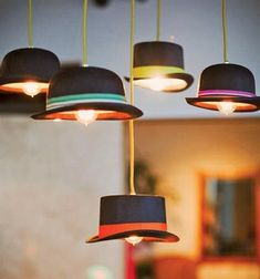 Matthew Parker Events crafted lighting fixtures for a speakeasy-themed wedding using hats from a party supply store, decorative ribbon, corded...