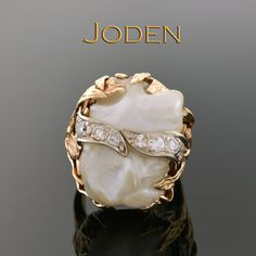 Made during the 1970's this baroque pearl ring is made with 2 pearls, so perfectly matched that when set side by side appear to be the same pearl. The bark finish on the gold, so popular during this time, brings a naturalistic style to the ring. This is a bold ring that is sure to make a statement.
