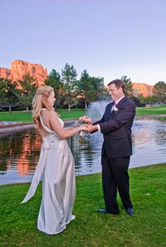 Ceremony Site Is Situated Beneath The Picture Perfect Backdrop Of Castle Rock On Tee With Lush Green Grounds Lake And Fountain Views