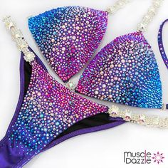 This truly daring fitness competition features a wonderfully effective blend of blue, red and clear crystals on a purple holographic fabric. Bikini Competition Workout Plan, Bikini Competition Suits, Figure Competition Suits, Fitness Competition, Bikini Workout, Bikini Fitness, Bodybuilding Competition, Scrunch Bikini Bottoms, Posing Suits