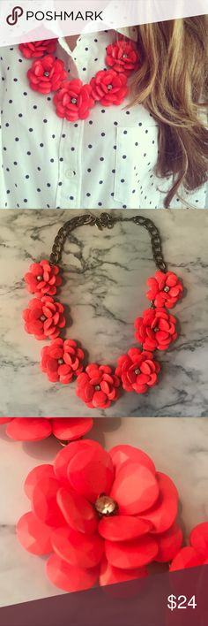 Neon Coral Rose Flower Burst Statement Necklace Instantly elevate your outfit with this fun and fashionable statement necklace. Bold neon coral-colored rose flowers with rhinestones at the center. Chain link with adjustable clasp closure. Jewelry Necklaces