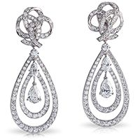 Fabergé Ruban de Lumière Earrings    This piece is set in 18 carat white gold and features pearshape, marquises and round white diamonds.