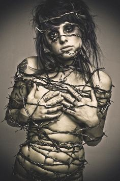 Living with chronic pain tattoo idea - what it feels like: wrapped in barb wire