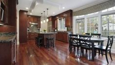 Dark, light, oak, maple, cherry cabinetry and dark wood kitchen cabinet ideas. CHECK THE PICTURE for Various Wood Kitchen Cabinets. Hardwood Floors In Kitchen, Wood Kitchen Cabinets, Kitchen Flooring, Kitchen Island, Kitchen Vinyl, Walnut Cabinets, Kitchen Peninsula, Dark Hardwood, Brown Cabinets