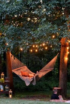 Backyard hammock plus tree lights makes magic. [Pin spotted on Amber Reagan\'s #MeTime board.]