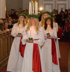 Santa Lucia, an old swedish tradition amongst the swedish speaking in Finland. I practiced this for 10 years when I was a child with my best friend who was Swedish. What a neat tradition.