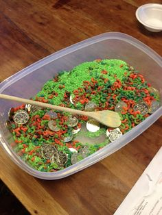 The sensory bin just keeps expanding! The coins and rice definitely add to the experience!!!!