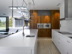 Home Design: Modern Kitchen White Counters White Kitchen Island Conventional Oven, Design, Furniture Galley Kitchen Design, Small Galley Kitchens, Modern Kitchen Design, Modern Kitchens, Kitchen Wall Covering, Painting Laminate Cabinets, Floor Design, House Design, Kitchen Colour Combination