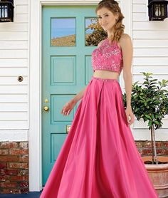 Two-Piece Satin long dress with Mesh beaded top and A-line skirt with side pockets. This beautiful two-piece prom dress comes in Blush, Royal, Hot Pink and Light Blue colors. POLY USA