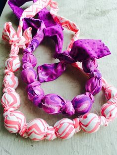 Teething necklaces wooden beads and fabric pink and purple
