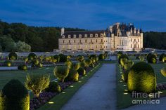 Lighted Gardens Of Chenonceau Photograph by Brian Jannsen