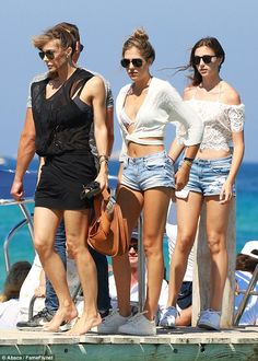 Picture perfect: Jennifer and her daughters proved they have some wondrous genes as they stepped on shore