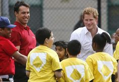 Big smiles...Prince Harry, New York Yankee Mark Teixera, and some fun loving kids all grin as the royal takes part in a Harlem, New York community sports project