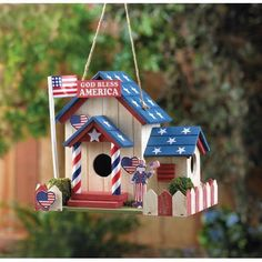 It doesn't come much more American than this! Many little red. white and blue touches make this patriotic birdhouse one that we wish we could live in ourselves. 2 entrances. Clean out hole in back. 8.