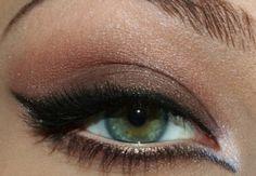 Earthtone makeup... looks like Aishwarya?