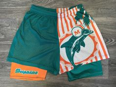 Miami Dolphins Shorts Vintage Wilson Mesh Elastic Waist Drawstring Double Layer legs NFL Football Florida USA Made Running Workout by sweetVTGtshirt on Etsy Nike Gear, Dolphin Shorts, Vintage Football, Florida Usa, Vintage Nike, Nfl Football, Elastic Waist, Stay Weird, Nfl