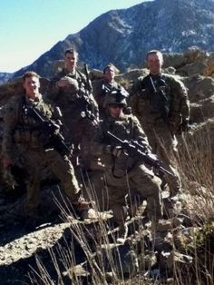 Spc. Brittany McGee (front), a field artillery surveyor for the 4th Brigade Combat Team (Airborne), 25th Infantry Division, and Soldiers with a light infantry squad from the 4-25th, stand on a mountain during a foot patrol in December 2011, in Paktya Province, Afghanistan. McGee was a member of the brigade's Female Engagement Team during the deployment.