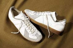 UNIFORMLY CHIC | Bonafide German Army trainers, at left, available at New York vintage shop...