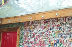 Trash into wall siding panels  Easy to collect and convert into siding. Perhaps if one community decided on using can collect all cans over the 1-2 weeks time. Appears to be very inexpensive and colorful too :)    Orginally found at: http://www.phoenixcommotion.com/index.php?option=com_k2&view=item&layout=item&id=39&Itemid=26&lang=en