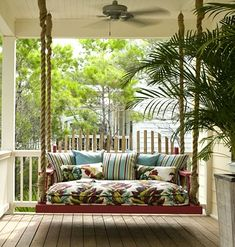 Swing Time ~ The large veranda on the front porch is the perfect spot for a large daybed swing. Hung with rope  fastened to actual boat cleats, the swing is filled with pillows 1940s-inspired barkcloth-covered cushions. Now this is a cozy spot!!! http://media-cache1.pinterest.com/upload/180636635024156192_vi8BC8eS_f.jpg ruthbarrows bedrooms peaceful lounges