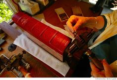 Eleanore Ramsey, hand bookbinder in her Sausalito studio. Old world style of gold tooling where she uses real gold leaf during the process on a bound cover.  Photographer:  Eric Luse / The Chronicle names (cq) from source  Eleanore Ramsey Photo: Eric Luse