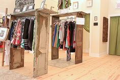 Recycled door frame clothing racks.  Another great recycle idea.