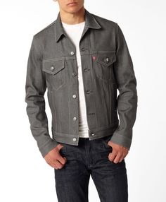 """Levi's Trucker Jacket in gray. I love it for men or women.  A Levi's classic since the 1870s, the jean jacket has changed design and names over the years, but never wavered on quality. Introduced in 1962, the now famous Trucker style used to be called """"Lot 557."""" Japanese vintage clothing collectors noticed they were popular among American truck drivers and dubbed them """"truckers."""""""