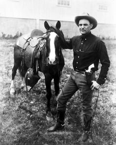 Tom Hickman, Texas Ranger, standing beside horse :: General Photograph Collection
