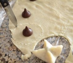 "Kiss Pies! So easy. Just pie crust and Hershey kisses, baked up into cute little ""pies"" :) What a sweet party idea."