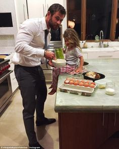 Snack time: Chris's Spanish actress wife Pataky shared a cute snap of the hunky star doting on his daughter in the kitchen after the premier of his movie The Huntsman: Winter's War in LA