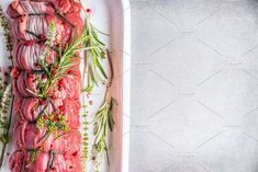 Raw roast beef with herbs by VICUSCHKA on @creativemarket